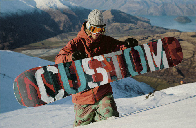 snowboarder hiking with burton custom flying v